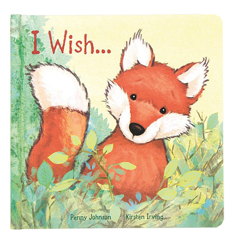 "A book cover featuring a young red and white fox sitting in green brush with the title ""I Wish"" in orange lettering"
