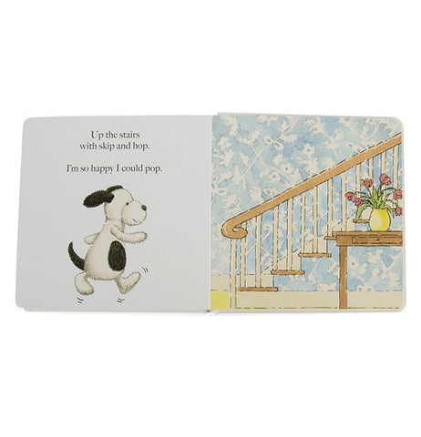 "A part of the book depicting the puppy ready to run up the stairs along with the passage ""Up the stairs with skip and hop, I'm so happy I could pop"""