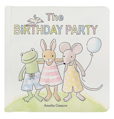 "A paperboard book is titled ""The Birthday party"". A white bird is on the ""T"" in birthday. An anthropomorphized frog, rabbit, and mouse are posing with their arms around each other. The mouse is holding a blue ballon."