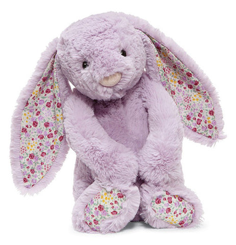 Stuffed Bunny that is purple and has pink and purple flowers on ears and feet