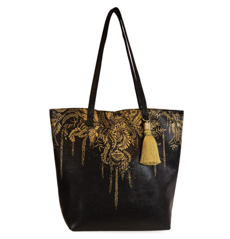 This black Tree of Life Tote Bag features a golden leaves design over the black bag with a carrying handle.