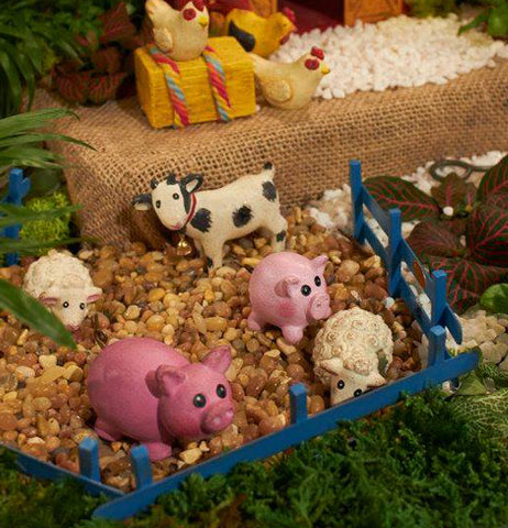 This mini blue fence panel is made for farm animal miniatures, such as pigs, sheep, and a cow.
