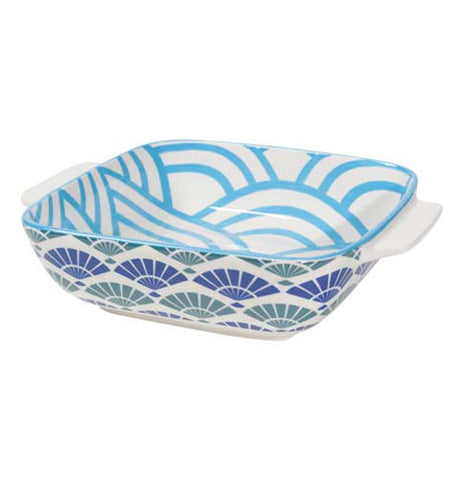 A baking dish with a dark blue and dark green design on the outside, and a lighter blue design of a hill-like pattern on the inside.