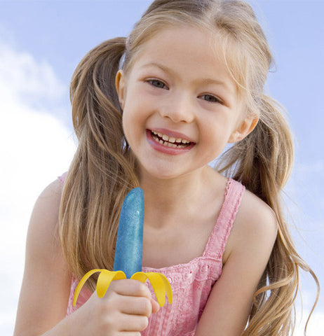 Girl enjoying the end results of the popsicle mold banana
