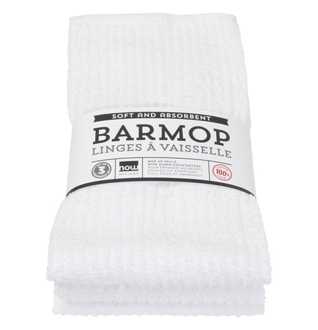 "This plain white dish towel is shown inside its cardboard packaging with the words, ""Barmop Linges A Vaisselle"" written across the middle in black lettering."