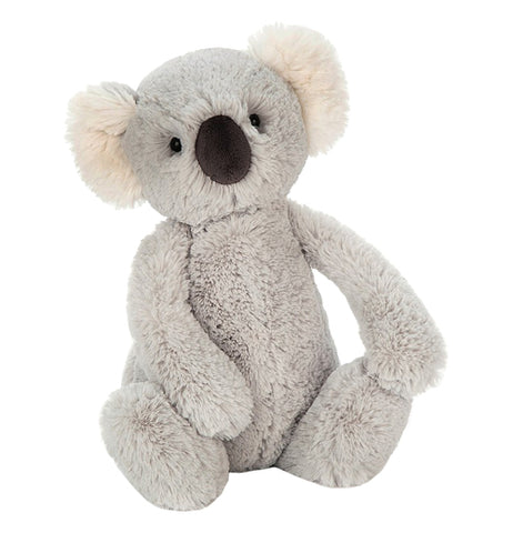 Medium grey stuffed koala facing forward with black button nose and plastic pellet eyes with white and grey ears.