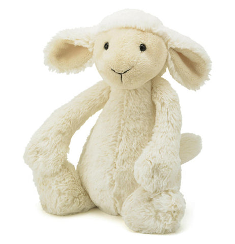 White plush lamb with cream colored face and ears
