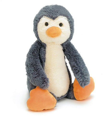 grey and white Penguin with orange feet and beak, black eyes