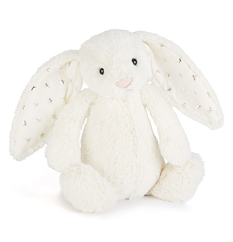 Front view of medium white bashful bunny with twinkle silver stars in its floppy ears and pink nose with black plastic pellet eyes.