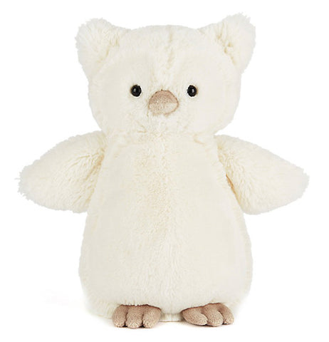 a plush white owl sitting there looking adorable