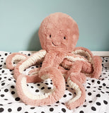 "This ""Odell Octopus"" lays on sort of a bed."