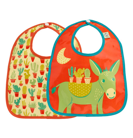 Two desert themed bibs that are brightly colored. One featuring many potted cacti covering the entire bib, the other of a green burro under the moon carrying cacti.