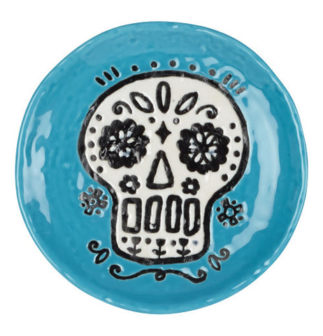 ceramic blue coaster with a white sugar skull