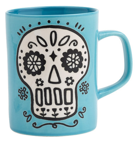 ceramic blue mug with white sugar skull