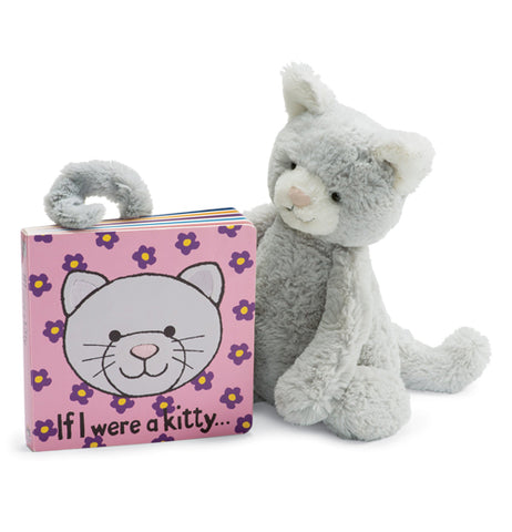 "The pink ""If i were a kitty"" book is shown sitting next to a stuffed grey kitty cat toy."