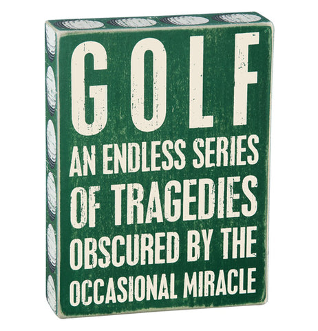 "Green wood box sign that says ""Golf an endless series of tragedies obscured by the occasional miracle."""