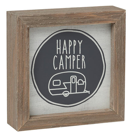 "A wooden box sign featuring a trailer with the phase ""Happy Camper"""