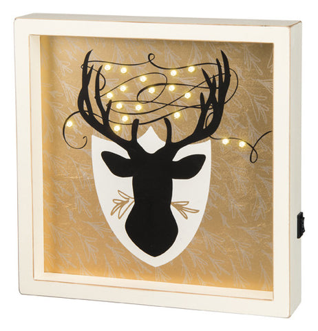 This box sign has L.E.D. deer headlights. The sign is tan with a large brown buck.