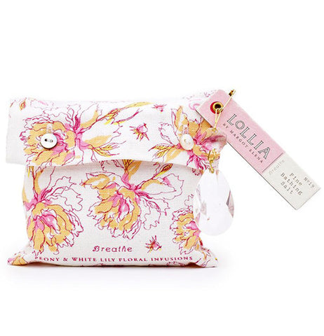 "Bath salts bag has large flowers in yellow, pink and white. There are 2 different lables the one on the bag says""Breath Peony & White Lily Floral Infusions."" The tag on the bag says ""Lollia By Margot Elena Fine Bathing Salt."""