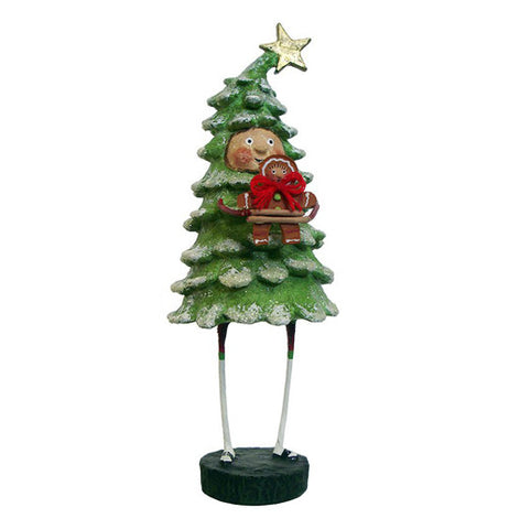 This figurine is of a person dressed like a spruce tree with a star on top, and holding a gingerbread man with a red ribbon around its neck.