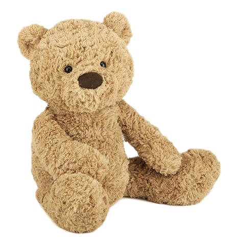 A light brown teddy bear is sitting to the front.