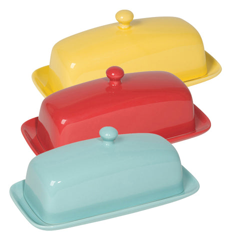 Wll three variants of this butter dish are shown, the eggshell in front, red in the middle, and lemon yellow in back, all are two pieces with a round knob on top of the cover.