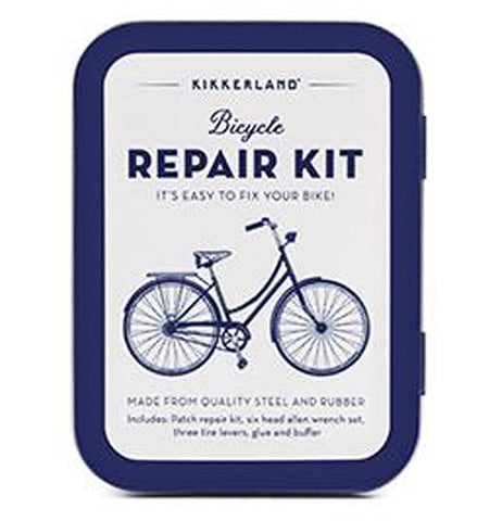 "This blue and white metal tin has a blue bicycle and the words, ""Kikkerland Bicycle Repair Kit"" above it in blue lettering."