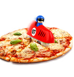 Red pizza slicer in the shape of a race car being used to cut a pizza.