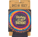 "This black mug cover features a circular design of vibrant blue, orange, magenta, purple, and red with the words, ""Hooray It's My Birthday"" in yellow lettering."