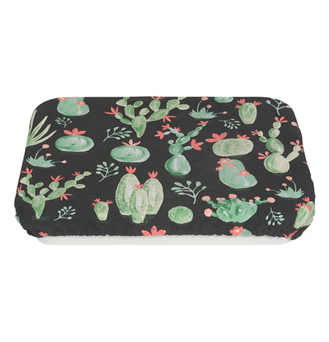 Cotton, polyurethane, and polyester baking dish cover with images of green and orange cacti over a black background.
