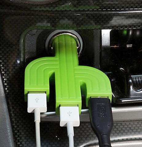 The cactus-shaped USB drive is shown plugged into a car's lighter socket.