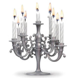 A silver candleholder with 9 candles that fits on a cake.