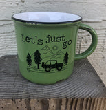 "The green ""Let's Just Go!"" Camp Mug sits on the fence post."