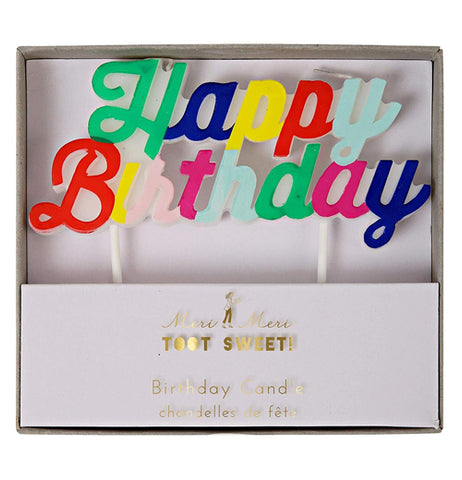 "This large wax candle spells out the words, ""Happy Birthday"" in green, blue, yellow, red, and pink lettering. On the lid of the box are the words, ""Meri Meri Toot Sweet Birthday Candle"" in gold lettering."