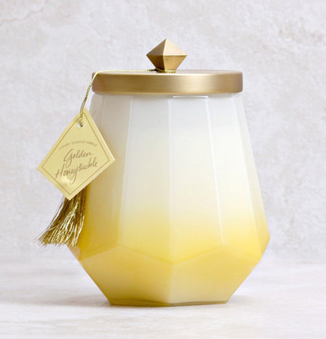 This candle is in a unique,laurel -shaped jar. it will fill your home with the fragrance of honey blossom,cashmere and soft wood.and neroli blossoms.