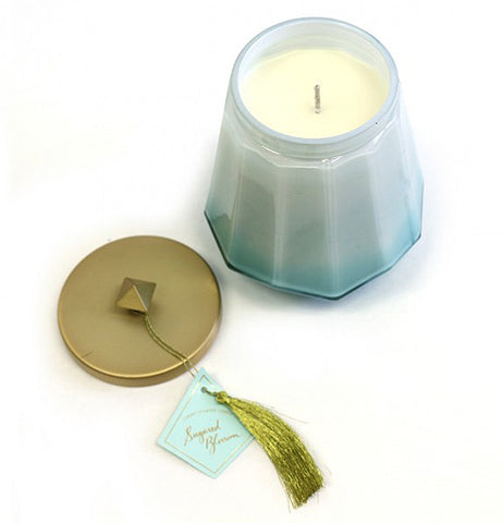 This candle is in a laurel shaped jar with the smell of jasmine petals,italian citron and Tahitan Vanilla bean.