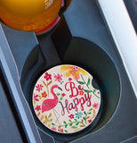 "The ""Be Happy Flamingos"" (Set of 2) Car Coasters sits well in the cup holder of the car."