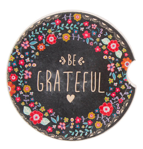"Beautifully floral decorated coaster saying ""be grateful""."