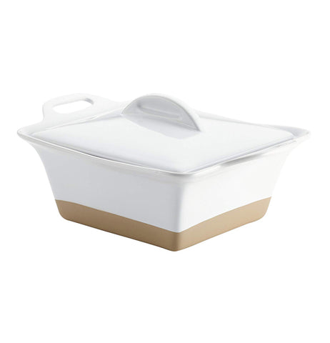 "Front view of ""White Square"" 2.5 quart casserole dish with white lid and top with handles and brown base."