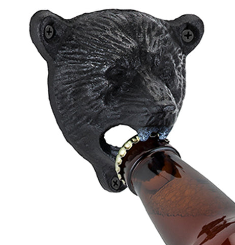 Bottle opener in the shape of a black bear head being used to open a beer bottle.