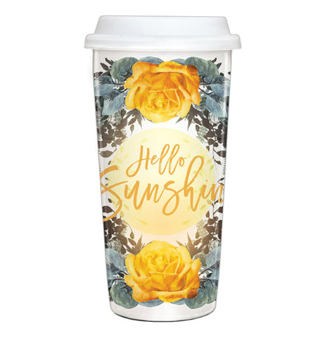 "This travel mug is yellow with blue and yellow flowers and says ""Hello Sunshine."""