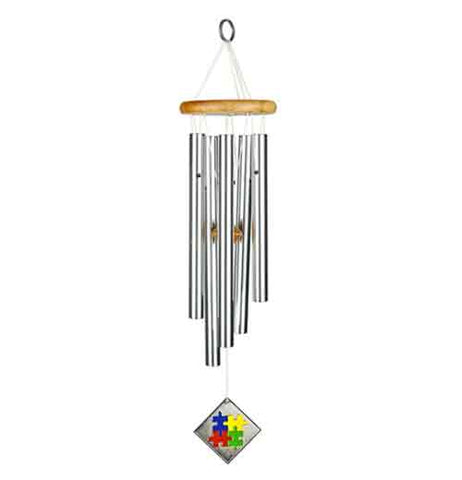 These silver colored chimes hang from a wood colored top with blue, yellow, red and green puzzle pieces hanging from the chimes.