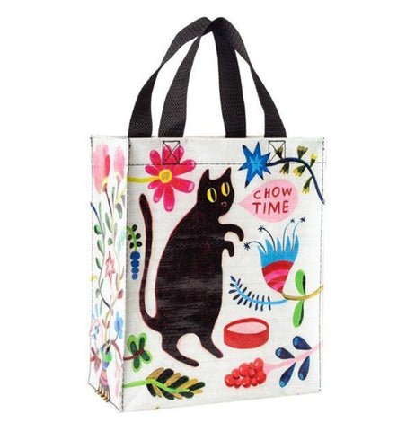 "This Handy Tote ""Chow Time"" bag has a design of a black cat with a speech bubble that reads ""Chow Time"" along with floral designs scattered all over the white bag."
