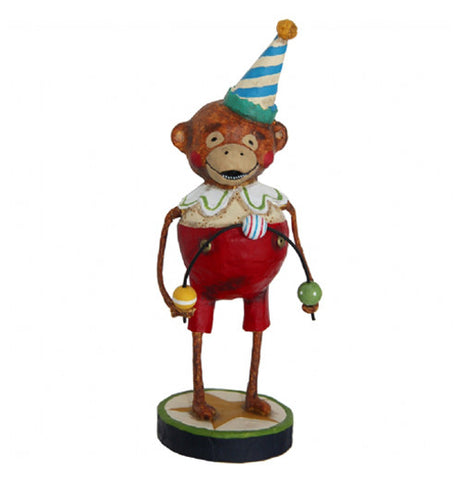 Monkey figurine dressed in a circus jugglers costume.  The costume is a red pair of overalls and he's got a blue and white birthday hat on.