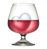 Heart shaped Ice cube in a wine glass