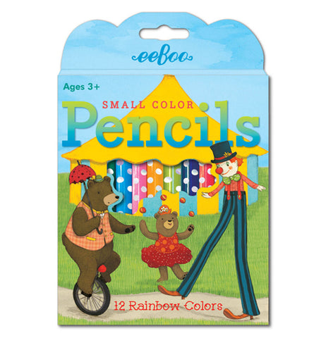 This box of colored pencils depicts two circus bears and a clown with long legs performing on a unicycle and doing leg work in front of a yellow circus tent. An opening in the box shows the different polka dotted colored pencils.