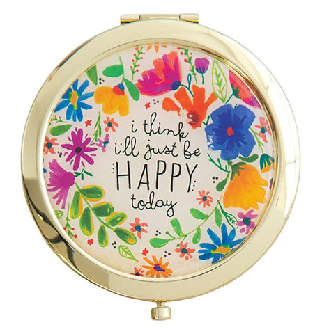 "The golden Compact Mirror features a colorful floral design and a message that says, ""I Think I'll Just Be Happy Today""."