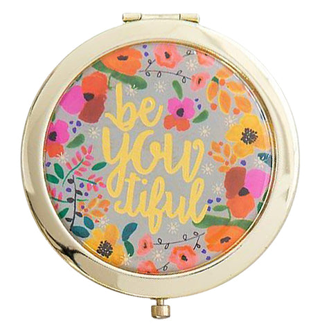 "This beautifully-colorful rounded compact mirror is surrounded with gold and flowers with a message ""Be You tiful""."