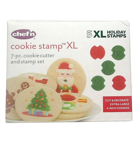 Front of cookie stamp XL box with red and green cookie stamps next to cookies decorated with Christmas themed designs.