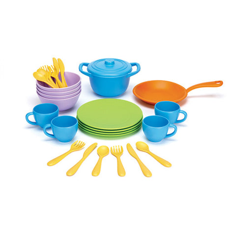 This child's play set includes four blue cups, four green plates, an orange skillet, a blue pot with lid, four purple bowls, and four sets of yellow knives, forks, and spoons
